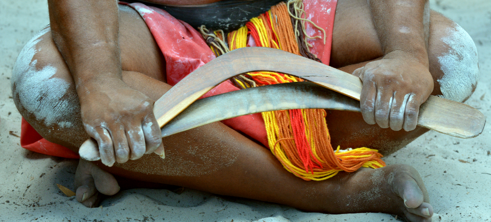Indigenous man with boomerang